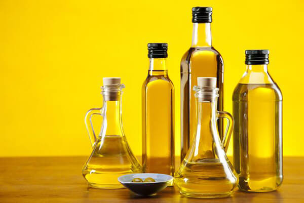 Why is sesame oil stored in glass bottles?